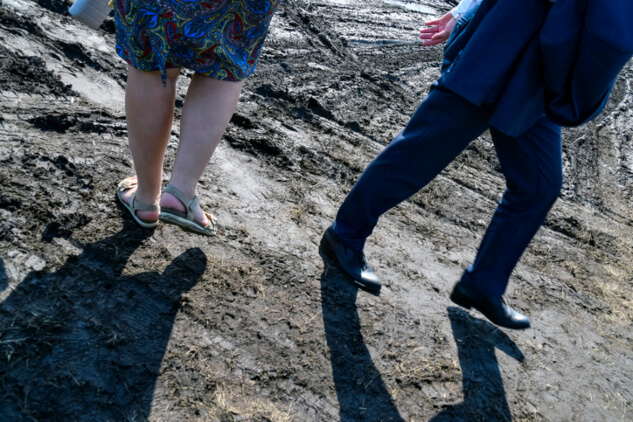Couple walks away form each other on Orange County Beach